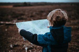 Boy searching map