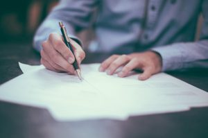 Reflective man writing